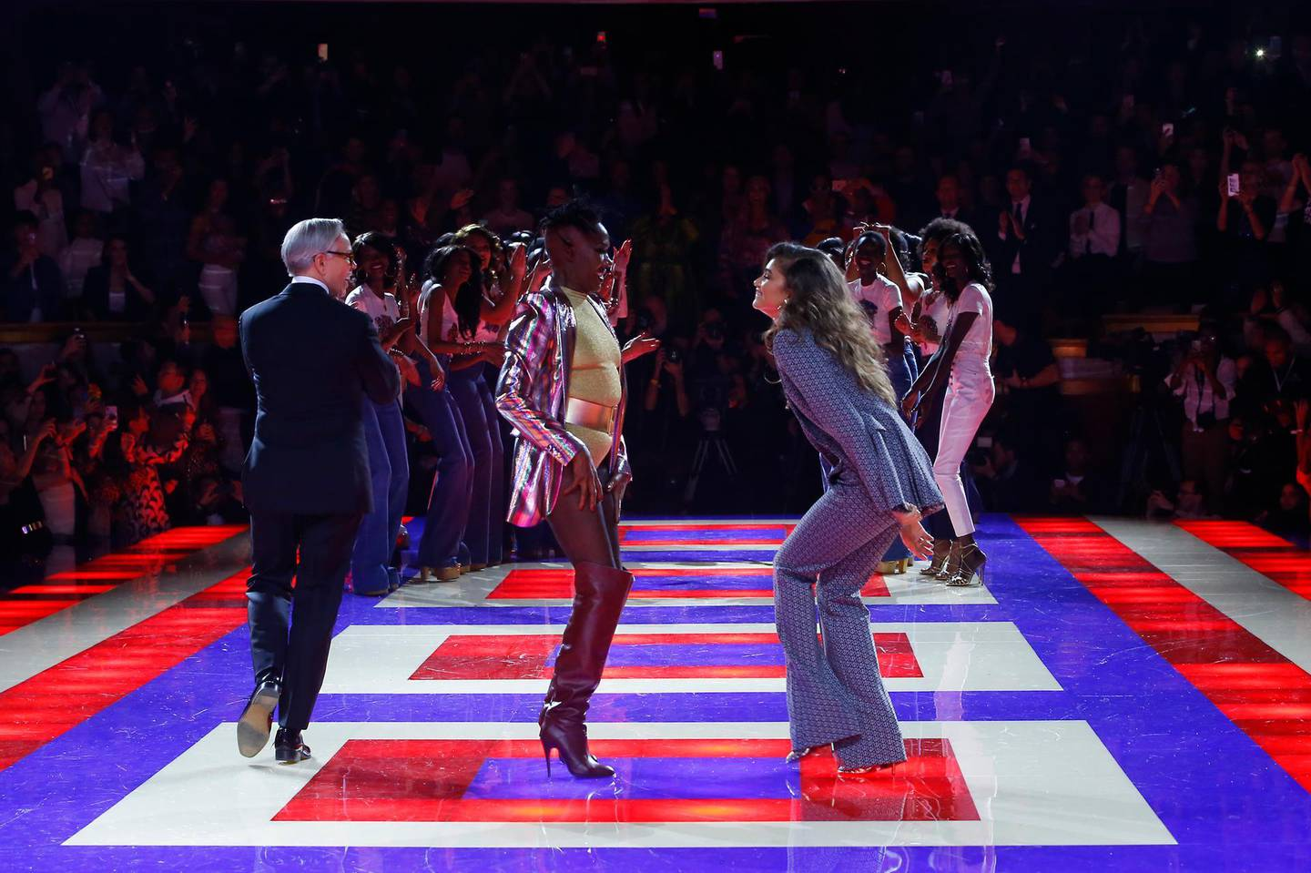 Designer Tommy Hilfiger, left, singer Grace Jones, centre, and actress Zendaya walk the runway with models at the conclusion of the Tommy Now ready to wear Fall-Winter 2019-2020 collection, that was presented in Paris, Saturday, March 2, 2019. (AP Photo/Michel Euler)