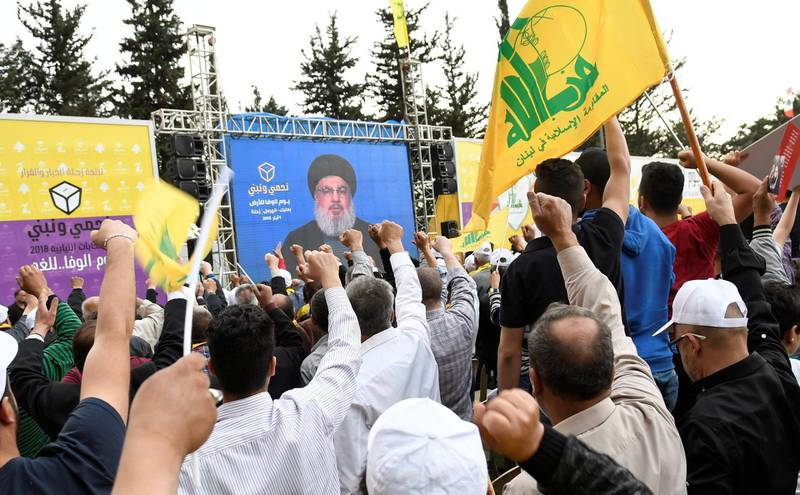REFILE - QUALITY REPEAT Hezbollah leader Sayyed Hassan Nasrallah is seen on a screen during election rallies a few days before the general election in Baalbeck, Lebanon, May 1, 2018.   REUTERS/Hasan Abdallah