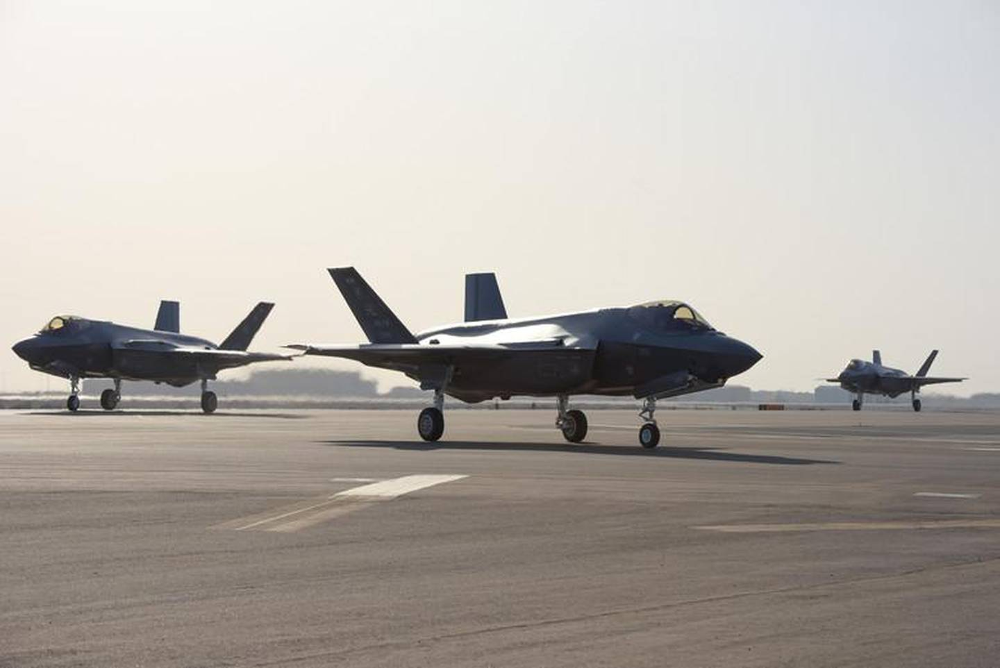 Three F-35A Lightning IIs assigned to the 4th Expeditionary Fighter Squadron taxi after landing at Al Dhafra Air Base, United Arab Emirates, April 15, 2019. The F-35A Lightning II is deployed to the Air Forces Central Command Area of Responsibility for the first time in U.S. Air Force history. (U.S. Air Force photo by Staff Sgt. Chris Thornbury)