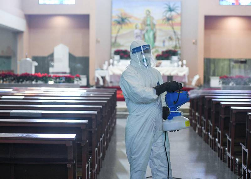 Abu Dhabi, United Arab Emirates - Thorough sanitization of all the facilities before the start of each mass at St. JosephÕs Cathedral, in Mushrif. Khushnum Bhandari for The National