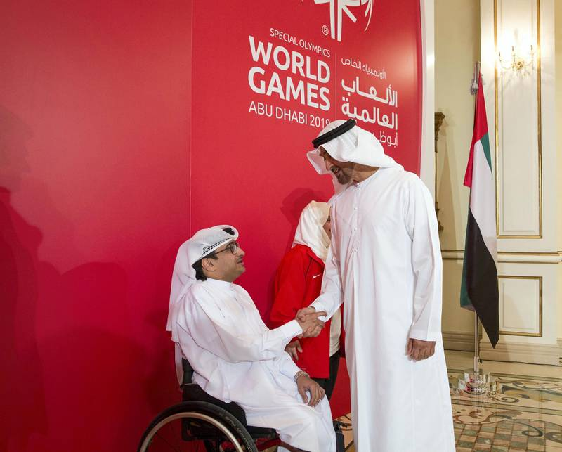 ABU DHABI, UNITED ARAB EMIRATES - January 23, 2017: HH Sheikh Mohamed bin Zayed Al Nahyan, Crown Prince of Abu Dhabi and Deputy Supreme Commander of the UAE Armed Forces (R) greets Majid Al Usaimi, National Director of the Special Olympics UAE (L) during an MOU signing ceremony at Sea Palace.  ( Mohamed Al Hammadi / Crown Prince Court - Abu Dhabi ) ---