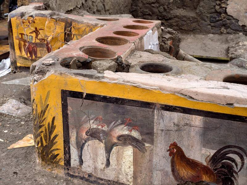 Frescoes on an ancient counter discovered during excavations in Pompeii, Italy, are seen in this handout picture released December 26, 2020. Pompeii Archaeological Park/Ministry of Cultural Heritage and Activities and Tourism/Luigi Spina/Handout via REUTERS REUTERS  THIS IMAGE HAS BEEN SUPPLIED BY A THIRD PARTY. NO RESALES. NO ARCHIVES