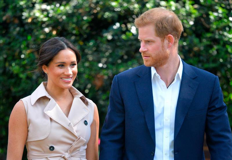 FILE - In this Wednesday Oct. 2, 2019 file photo, Britain's Harry and Meghan, Duchess of Sussex arrive at the Creative Industries and Business Reception at the British High Commissioner's residence, in Johannesburg, where they will meet with representatives of the British and South African business communities, including local youth entrepreneurs. British media reports said Friday Oct. 4, 2019 that Britian's Prince Harry has launched legal proceeds at the High Court against two British tabloid newspapers over alleged phone hacking. (Dominic Lipinski/Pool via AP, File)
