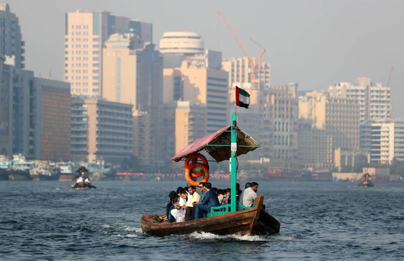 Dubai, United Arab Emirates - June 18, 2019: Water taxis on Dubai creek take people from Bur Dubai to Deira and back again at sunset. Tuesday the 18th of June 2019. Bur Dubai/Deira, Dubai. Chris Whiteoak / The National