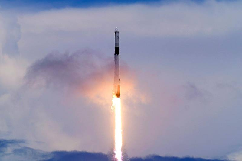 A SpaceX Falcon 9 rocket with a Dragon 2 spacecraft lifts off on Pad 39A at the Kennedy Space Center for a re-supply mission to the International Space Station from Cape Canaveral, Fla., Thursday, June 3, 2021. (AP Photo/John Raoux)