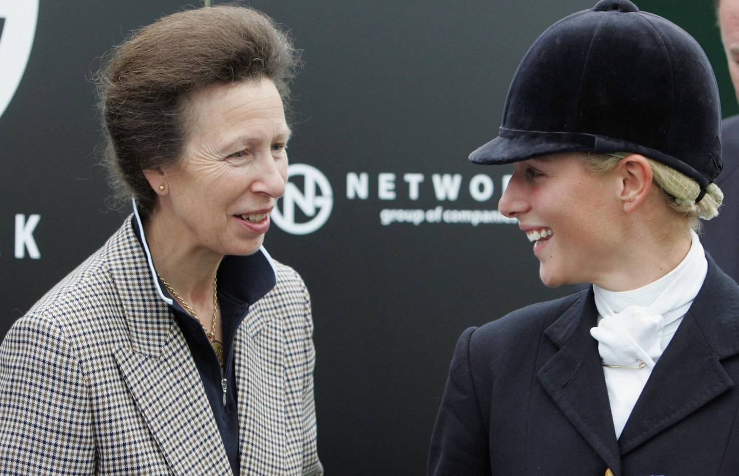 GATCOMBE, ENGLAND - SEPTEMBER 17: 2006 World Champion, Zara Phillips shares a joke with her mother, Princess Anne, Princess Royal as she is presented with an award during the Gatcombe Horse Trials August 17, 2006, Gatcombe, England. (Photo by Matt Cardy/Getty Images)