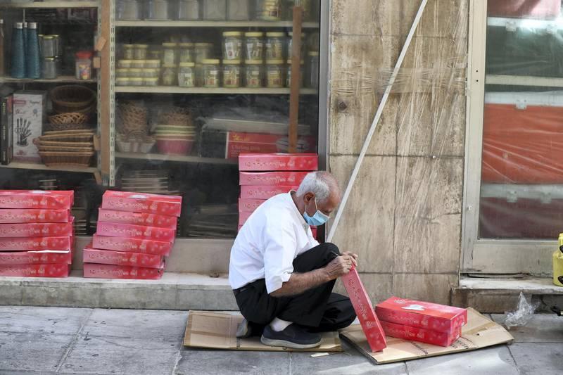 Dubai, United Arab Emirates - Reporter: N/A. News. Coronavirus/Covid-19. A man sorts out his stock in Bur Dubai. Saturday, October 17th, 2020. Dubai. Chris Whiteoak / The National