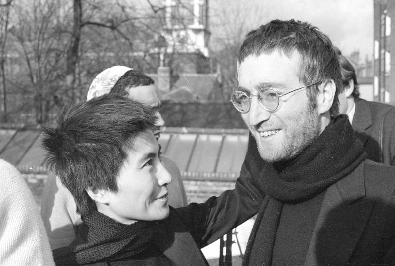 4th February 1970:  John Lennon (1940 - 1980) and Yoko Ono in London after having their hair cut. The hair was given to the Black Power leader Michael X in exchange for a pair of Muhammad Ali's shorts. Both the hair and the shorts will be auctioned for charity.  (Photo by Central Press/Hulton Archive/Getty Images)