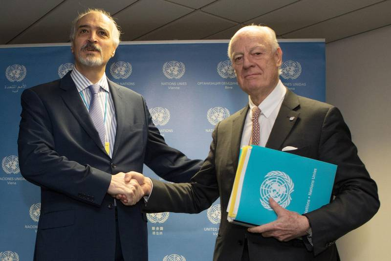 UN envoy Staffan de Mistura (R) and Syrian chief negotiator and Ambassador of the Permanent Representative Mission of Syria to the United Nations Bashar al-Jaafari shake hands before the start of talks on Syria in Vienna on January 25, 2018. The UN will make a fresh push to jumpstart Syrian peace talks, as violence continues to rage in a seven-year-old war that has killed more than 340,000 people. / AFP PHOTO / ALEX HALADA