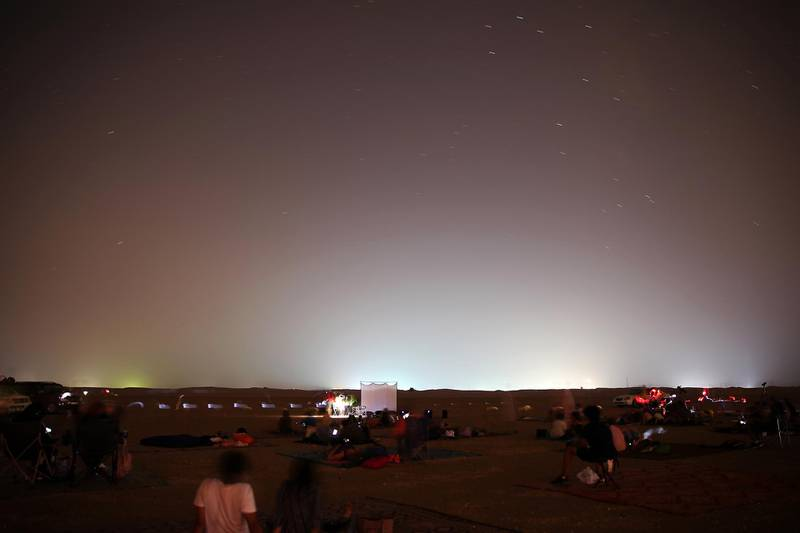 DUBAI, UNITED ARAB EMIRATES , August 13 – 2020 :- People watching the Perseid meteor shower at the Al Qudra desert area in Dubai. The event was organized by Dubai Astronomy Group with all the precaution against Covid 19 such as safe distance between the families and mask was mandatory. The event started on August 12 at 10pm to 2am on August 13.  (Pawan Singh / The National) For News/Standalone/Online/Instagram/Big Picture