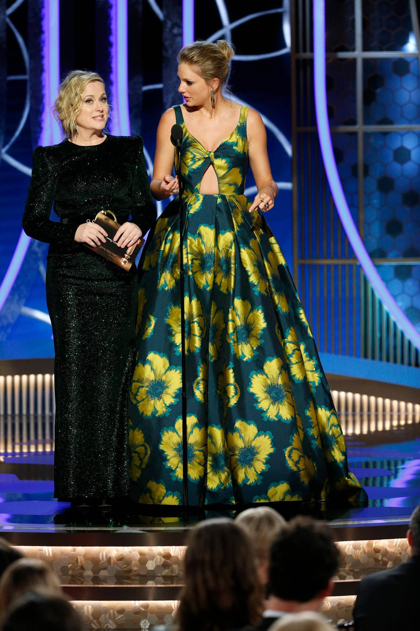 This image released by NBC shows presenters Amy Poehler, left, and Taylor Swift at the 77th Annual Golden Globe Awards at the Beverly Hilton Hotel in Beverly Hills, Calif., on Sunday, Jan. 5, 2020. (Paul Drinkwater/NBC via AP)