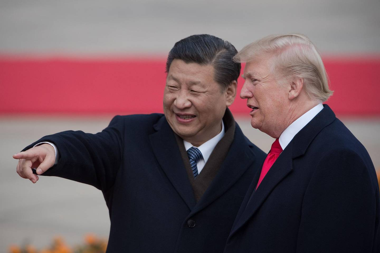 """(FILES) In this file photo taken on November 08, 2017 China's President Xi Jinping (L) and US President Donald Trump attend a welcome ceremony at the Great Hall of the People in Beijing.  The new partial trade agreement between the United States and China will be signed in the middle of next month in Washington, US President Donald Trump said on December 31, 2019. """"I will be signing our very large and comprehensive Phase One Trade Deal with China on January 15,"""" Trump tweeted moments before Wall Street was due to open. """"The ceremony will take place at the White House. High level representatives of China will be present."""" Trump said he would then travel to Beijing to continue negotiations """"at a later date.""""  / AFP / NICOLAS ASFOURI"""