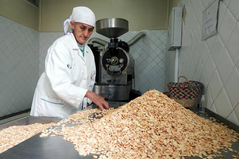 An Amazigh woman works on argan kernels at Women's Agricultural Cooperative Taitmatine, in Tiout, near Taroudant, Morocco June 10, 2021. Picture taken June 10, 2021. REUTERS/Abdelhak Balhaki