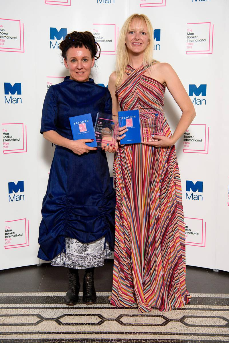 Polish author Olga Tokarczuk, left, stands with translator Jennifer Croft after winning the Man Booker International prize 2018, for her book Flights, at the Victoria and Albert Museum Tuesday, May 22, 2018 in London. (Matt Crossick//PA via AP)