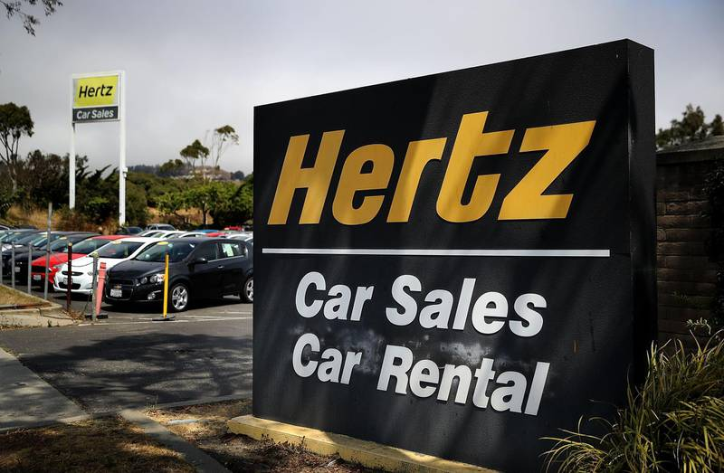 (FILES) In this file photo a sign is posted in front of a Hertz car sales and rental office on August 8, 2017 in South San Francisco, California.  After laying off 10,000 employees in North America in the wake of the coronavirus's massive hit to tourism, the company the car-rental giant Hertz has filed for bankruptcy on May 22. / AFP / GETTY IMAGES NORTH AMERICA / JUSTIN SULLIVAN