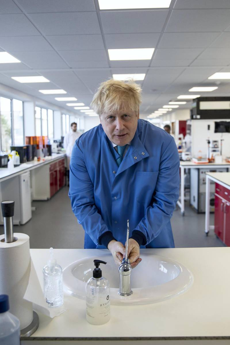 BEDFORD, ENGLAND - MARCH 06: Prime Minister Boris Johnson washes his hands during a visit to the Mologic Laboratory in the Bedford technology Park on March 06, 2020 in Bedford, England. The Prime Minister is announcing a £46 million funding package to help UK scientists develop testing kits and a vaccine in the fight against the Coronavirus. (Photo by Jack Hill - WPA Pool / Getty Images)