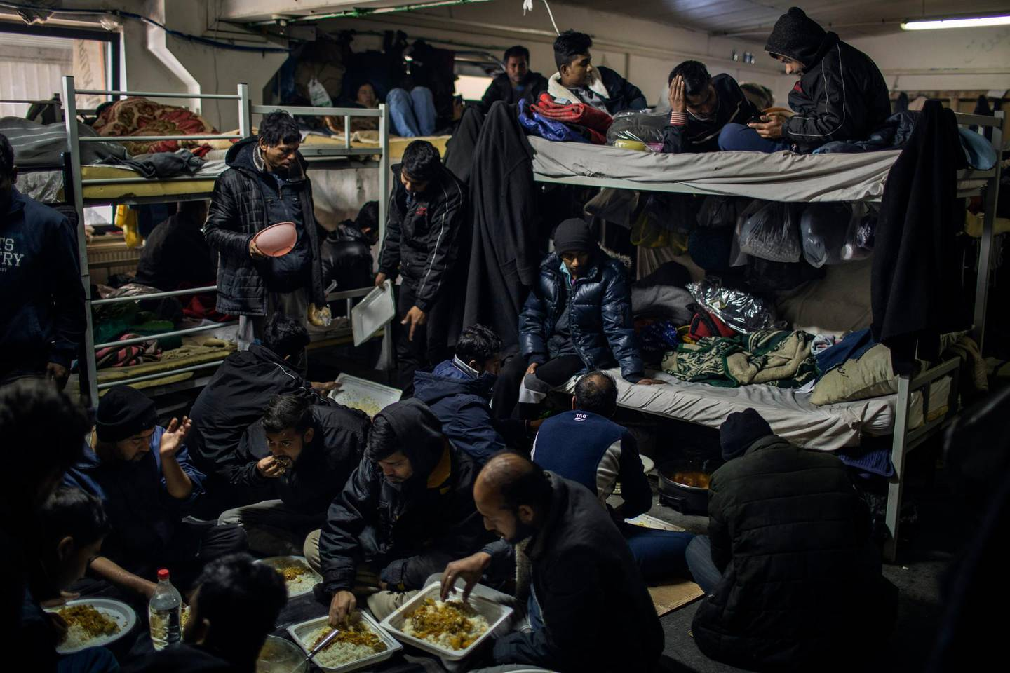 Migrants mostly from Bangladesh are living in an overcrowded room in the Miral camp in Velika Kladusa.