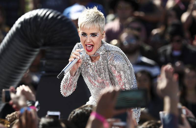 """FILE - In this Monday, June 12, 2017, file photo, Katy Perry performs during 'Katy Perry - Witness World Wide' exclusive YouTube Livestream Concert at Ramon C. Cortines School of Visual and Performing Arts in Los Angeles. The pop star's """"Witness: The Tour"""" is pushing back the start of her new tour to Sept. 19 in Montreal. Perry said in a statement Thursday, Aug. 17, that """"major elements of my tour stage design could not be available for me to rehearse on until this week."""" (Photo by John Salangsang/Invision/AP, File)"""
