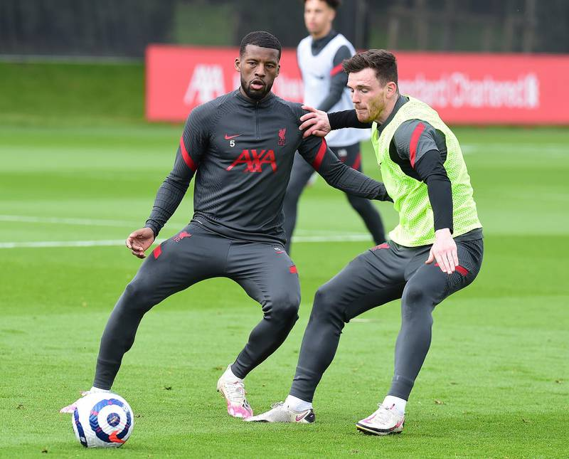 KIRKBY, ENGLAND - APRIL 28:(THE SUN OIUT. THE SUN ON SUNDAY OUT) Georginio Wijnaldum and Andy Robertson of Liverpool during a training session at AXA Training Centre on April 28, 2021 in Kirkby, England. (Photo by John Powell/Liverpool FC via Getty Images)