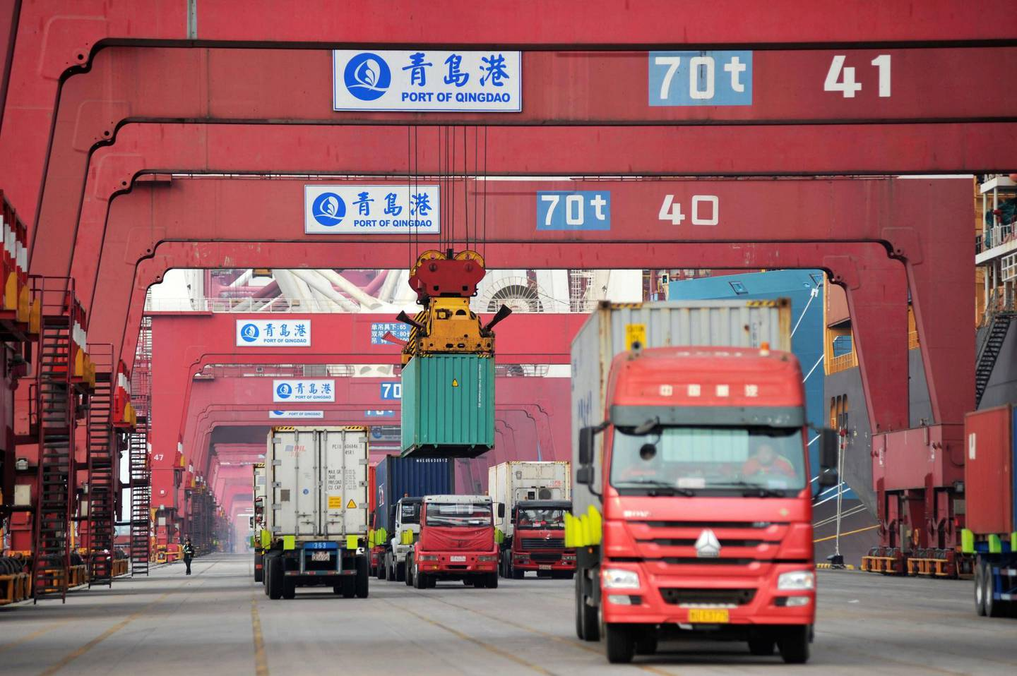 epa06644666 (FILE) - Trucks transport containers at a port in Qingdao, Shandong province, China, 08 March 2018 (issued 04 April 2018). China will place 25 percent tariffs on a list of 106 US goods, in a retaliatory action against the US's new tariff on Chinese products.  EPA/YU FANGPING CHINA OUT