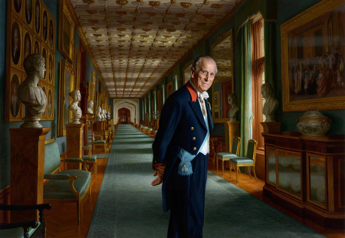 Prince Philip, Duke Of Edinburgh Dies at the Age of 99 announced on April 9,2021. UNITED KINGDOM - UNDATED:  (NOTE TO EDITORS: This handout photo may only be used in for editorial reporting purposes for the contemporaneous illustration of events, things or the people in the image or facts mentioned in the caption. Reuse of the picture may require further permission from the copyright holder.)   In this undated handout issued by Buckingham Palace of a painting by Australian born artist Ralph Heimans, A painting of Prince Philip, Duke of Edinburgh is photographed in the year of his retirement from public engagements set in The Grand Corridor at Windsor Castle with him depicted wearing the sash of the Order of the Elephant, Denmark's highest-ranking honour in 2017 in England. (Photo by Ralph Heimans/Buckingham Palace/PA Wire via Getty Images) Getty Images provides access to this publicly distributed image for editorial purposes and is not the copyright owner. Additional permissions may be required and are the sole responsibility of the end user.