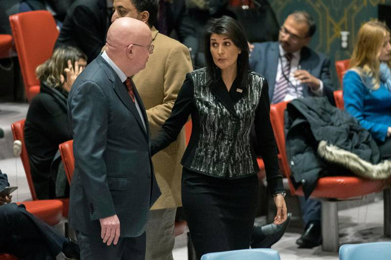 Russian Ambassador to the United Nations Vasily Nebenzya, left, speaks to American Ambassador to the United Nations Nikki Haley before a Security Council meeting on Iran, Friday, Jan. 5, 2018, at United Nations headquarters. (AP Photo/Mary Altaffer)