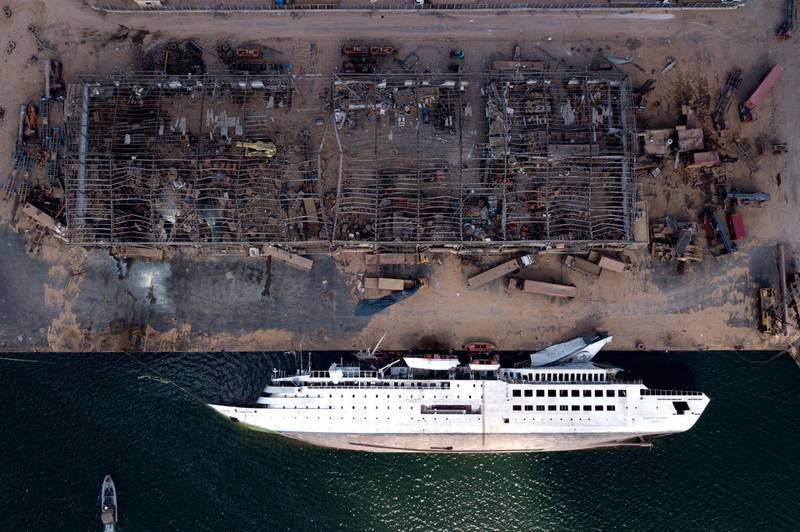 epa08598952 A picture taken with a drone shows a capsized ship lies at port area four days after explosions that hit Beirut port, in Beirut, Lebanon, 08 August 2020 (issued 12 August 2020). Lebanese Health Ministry said at least 171 people were killed, and more than 6000 injured in the Beirut blast that devastated the port area on 04 August and believed to have been caused by an estimated 2,750 tons of ammonium nitrate stored in a warehouse..  EPA/STR
