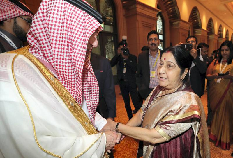Abu Dhabi, United Arab Emirates - March 01, 2019: Indian Foreign Minister Sushma Swaraj speaks to Adel Al Jubeir, Saudi Minister of State for foreign affairs at the OIC Ministerial Meeting. Friday the 1st of March 2019 at Emirates Palace, Abu Dhabi. Chris Whiteoak / The National