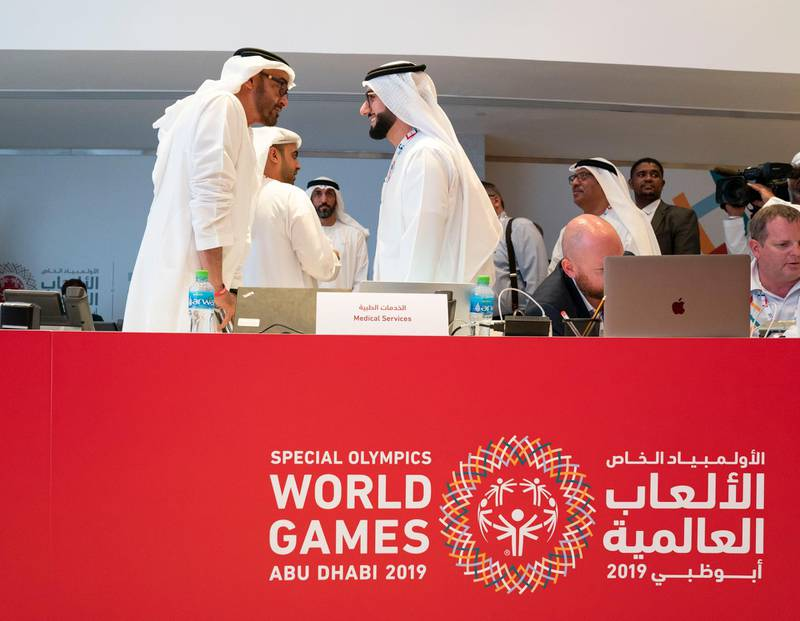 ABU DHABI, UNITED ARAB EMIRATES - March 20, 2019: HH Sheikh Mohamed bin Zayed Al Nahyan, Crown Prince of Abu Dhabi and Deputy Supreme Commander of the UAE Armed Forces (L) tours Special Olympics World Games Abu Dhabi 2019 at Abu Dhabi National Exhibition Centre.   ( Mohamed Al Hammadi / Ministry of Presidential Affairs ) ---