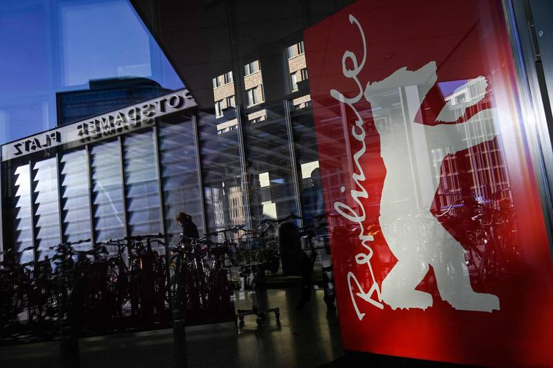 (FILES) In this file photo taken on February 15, 2019 a poster depicting the logo of the Berlin film festival is pictured at the Potsdamer Platz during the 69th Berlinale film festival. Berlin's international film festival next month will feature 18 movies made at least in part under the pandemic in competition for its coveted Golden Bear top prize, organisers said on February 11, 2021. / AFP / JOHN MACDOUGALL