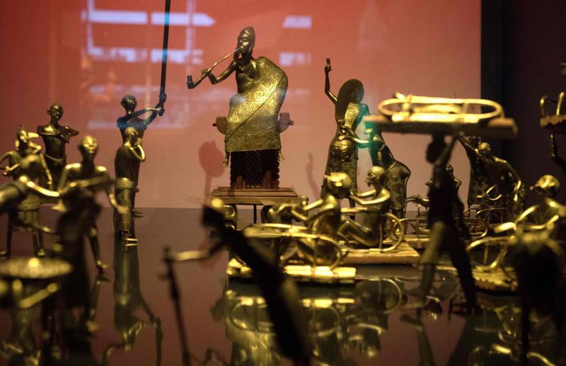 The Ato ceremony of the Kingdom of Dahomey, circa 1934, is pictured, on June 18, 2018 at the Quai Branly Museum-Jacques Chirac in Paris. Benin is demanding restitution of its national treasures that had been taken from the former French colony Dahomey (current Benin) to France and currently are on display at Quai Branly, a museum featuring the indigenous art and cultures of Africa. / AFP / GERARD JULIEN