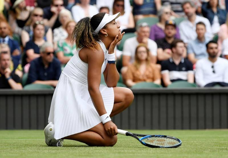 Tennis - Wimbledon - All England Lawn Tennis and Croquet Club, London, Britain - July 1, 2019  Japan's Naomi Osaka reacts during her first round match against Kazakhstan's Yulia Putintseva   REUTERS/Tony O'Brien