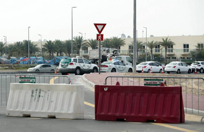 DUBAI, UNITED ARAB EMIRATES , April 18– 2020 :- Dubai Police checking vehicle entering from Manama street to International City in Dubai. Only two entrance are open for vehicles coming from Al Awir road before the Dragon Mart 1 and Manama Street to International City in Dubai.  Dubai is conducting 24 hours sterilisation programme across all areas and communities in the Emirate and told residents to stay at home. UAE government told residents to wear face mask and gloves all the times outside the home whether they are showing symptoms of Covid-19 or not.  (Pawan Singh / The National) For News/Online