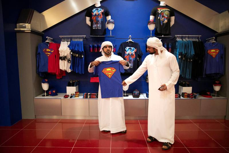 ABU DHABI, UNITED ARAB EMIRATES - JULY 24, 2018. A group of men at a shop in Metropolis in Warner Bros World Abu Dhabi.Almost 15,000 tickets for Warner Bros World Abu Dhabi have been sold ahead of opening to the public on Wednesday.(Photo by Reem Mohammed/The National)Reporter: Section: NA + AL