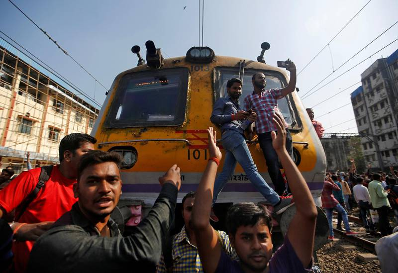 People shout slogans as they block train services during a protest demanding recruitment into the railway services in Mumbai, India, March 20, 2018. REUTERS/Francis Mascarenhas
