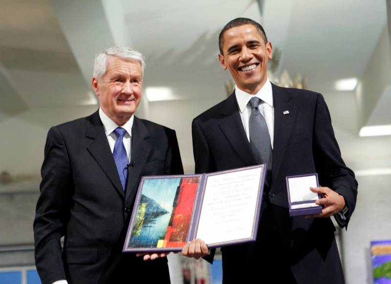 Nobel Peace Prize laureate, US President Barack Obama poses with his diploma and medal next to the Chairman of the Norwegian Nobel Committee, Thorbjoern Jagland (L) during the Nobel Peace prize award ceremony at the City Hall in Oslo on December 10, 2009. The president faces a tricky task of reconciling the revered honor with his decision just last week to send 30,000 troops to escalate the war in Afghanistan, a move which tripled the US force there since he took office.  AFP PHOTO / SCANPIX NORWAY / STR (Photo by STR / SCANPIX NORWAY / AFP)
