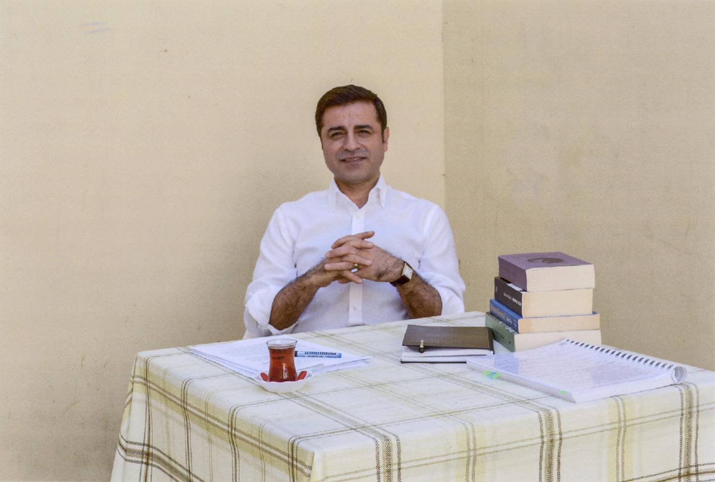 """In this handout photo provided by the pro-Kurdish Peoples's Democratic Party (HDP), former party leader Selahattin Demirtas and current Turkish presidential candidate, sits in prison in Edirne on May 4, 2018.  The HDP announced the nomination of Demirtas for the upcoming presidential elections in Turkey, scheduled for June 24, 2018. Demirtas, who has been behind bars since November 2016, is in prison accused of links to outlawed Kurdish rebels and is facing a 142-year sentence on charges of leading a terror organization. It's unclear if Turkey's electoral board will approve Demirtas's candidacy. / AFP PHOTO / Kurdish Peoples's Democratic Party (HDP) / HANDOUT / RESTRICTED TO EDITORIAL USE - MANDATORY CREDIT """"AFP PHOTO / HDP"""" - NO MARKETING NO ADVERTISING CAMPAIGNS - DISTRIBUTED AS A SERVICE TO CLIENTS"""