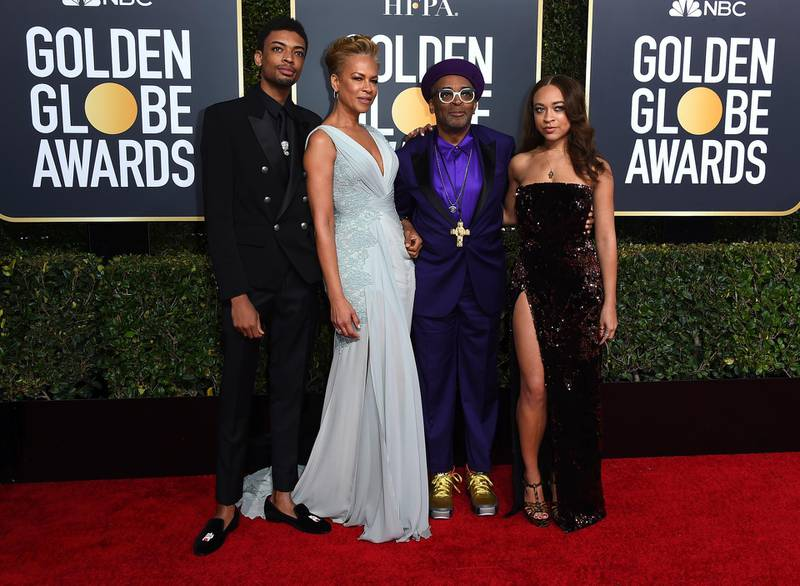 FILE - Director Spike Lee, second right, and his family, from left, son Jackson Lee, wife Tonya Lewis Lee and daughter Satchel Lee, right, arrive at the 76th annual Golden Globe Awards in Beverly Hills, Calif. on  Jan. 6, 2019. Lee's daughter and son have been chosen as the Golden Globe ambassadors to assist with the awards ceremony. The Hollywood Foreign Press Association announced Tuesday, Jan. 12, 2021, that Satchel and Jackson Lee will assume the ambassador roles for the 78th annual Golden Globes Awards in February. (Photo by Jordan Strauss/Invision/AP, File)