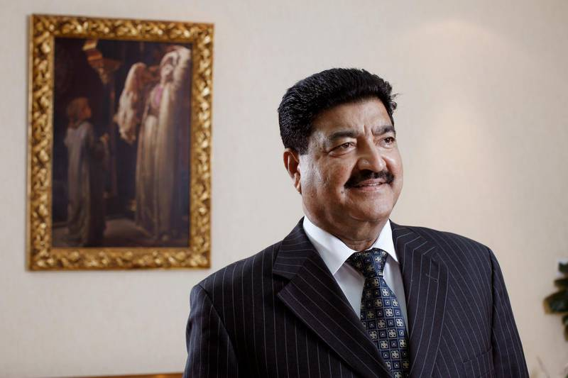 ABU DHABI, UNITED ARAB EMIRATES - December 31, 2009: Dr B. R. Shetty, Managing Director and CEO of NMC Group (NMC Specialty Hospital, UAE Exchange, Neopharma) stands for a portrait in his office.  ( Ryan Carter / The National ) *** Local Caption ***  RC003-DrShetty20091231.jpg