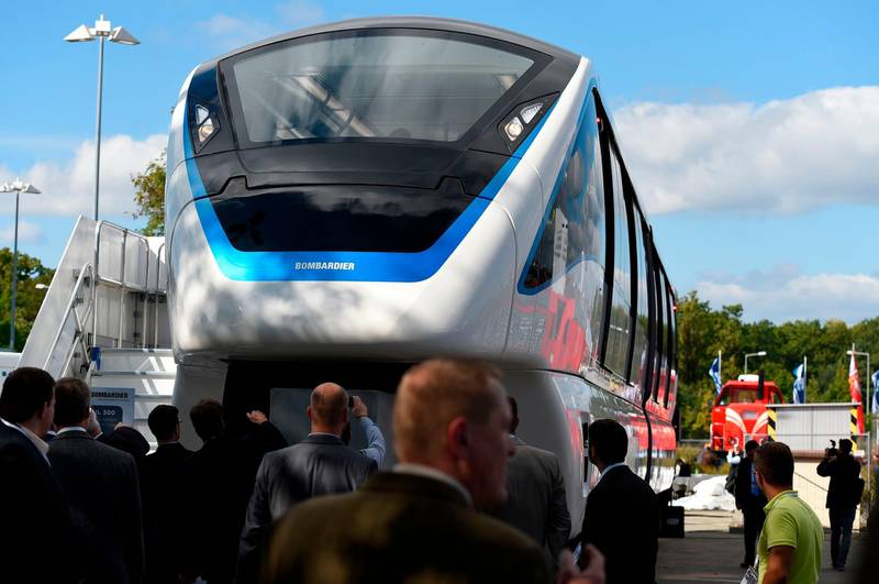 (FILES) In this file photo taken on September 23, 2014 The Innovia Monorail 300 by Bombardier is on display at the opening day of the Innotrans International Trade Fair for Transport and Mobility in Berlin. Canadian manufacturing group Bombardier announced on August 5, 2019 it had signed a multi-billion dollar agreement to build two automated monorail lines in Egypt's notoriously congested capital Cairo.  / AFP / Tobias SCHWARZ