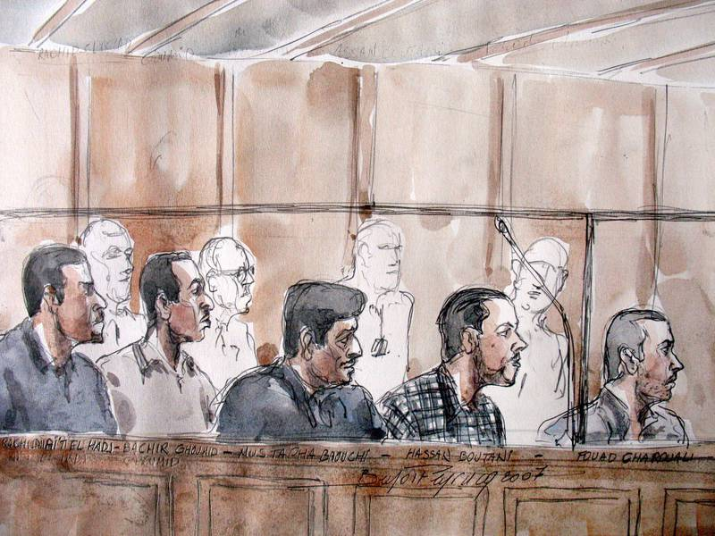 An artist rendering shows (From L) Rachid Ait El Hadj, Bachir Ghoumid, Mustapha Baouchi, Hassan Boutani and Fouad Charouali, accused of being members of a terrorist cell that helped stage the 2003 Casablanca bombings which killed 45 people and left dozens injured, waiting for the beginning of their trial, 04 June 2007 in Paris. Eight men -- a Turkish national and seven Moroccans or French nationals of Moroccan origin -- were arrested in a Paris suburb in 2004 and face charges of criminal conspiracy in relation with a terrorist undertaking. They are accused of being members of the Moroccan Islamic Combatant Group (GICM), which is suspected of having links to Al-Qaeda and of involvement in the Madrid train bombings in 2004. The trial is scheduled to continue until 20 June 2007.  AFP PHOTO BENOIT PEYRUCQ (Photo by BENOIT PEYRUCQ / AFP)