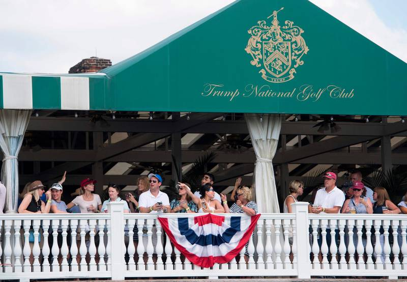 (FILES) In this file photo taken on July 16, 2017 people watch as US President Donald Trump arrives at the 72nd US Women's Open Golf Championship at Trump National Golf Course in Bedminster, New Jersey. The PGA of America pulled the 2022 PGA Championship from the Trump Bedminster course in New Jersey on January 10, 2021, days after supporters of President Donald Trump attacked the US Capitol. / AFP / SAUL LOEB
