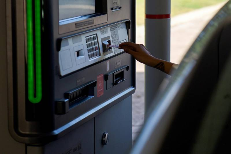 A customer uses a drive-thru automated teller machine (ATM) at a Bank of America Corp. branch in San Antonio, Texas, U.S., on Thursday, July 12, 2018. Bank of America Corp. is scheduled to release earnings figures on July 16. Photographer: Callaghan O'Hare/Bloomberg