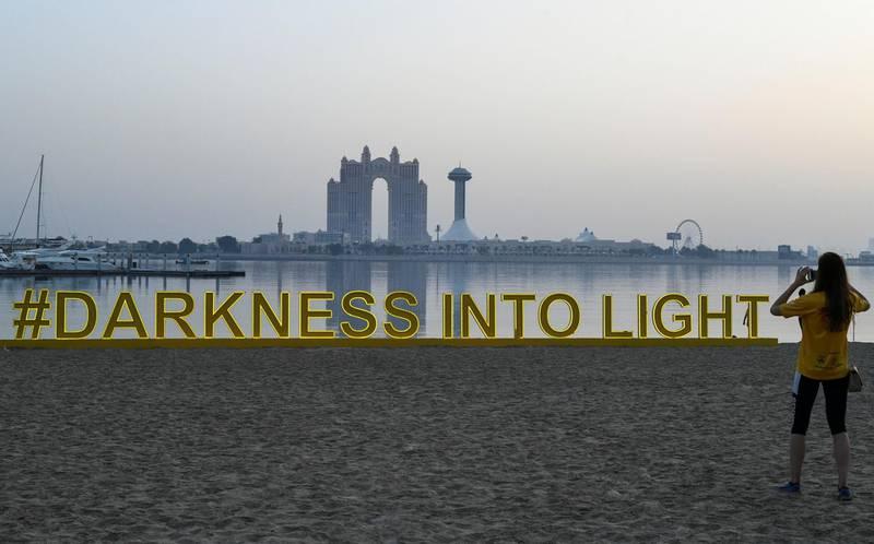 Abu Dhabi, United Arab Emirates - Photo opportunity at the Darkness into Light walk, Emirates Palace. Khushnum Bhandari for The National