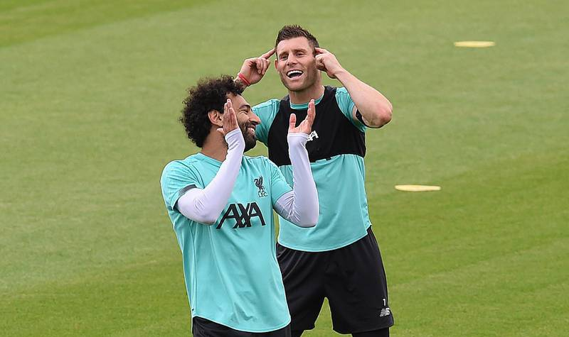 LIVERPOOL, ENGLAND - JUNE 19: (THE SUN OUT. THE SUN ON SUNDAY OUT) Mohamed Salah of Liverpool with James Milner of Liverpool during a training session at Melwood Training Ground on June 19, 2020 in Liverpool, England. (Photo by John Powell/Liverpool FC via Getty Images)