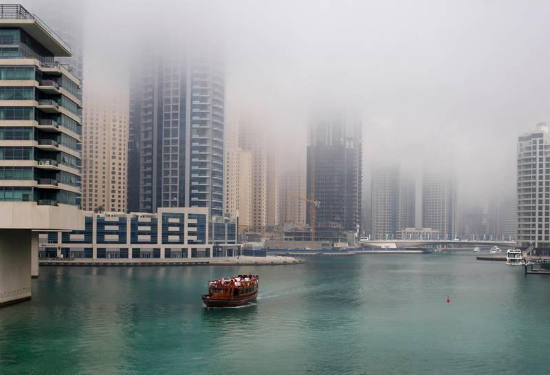 Dubai, March 15, 2013 - Afternoon fog descends on Dubai Marina in Dubai, March 15, 2013. (Photo by: Sarah Dea/The National)