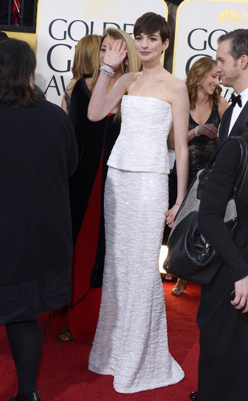 epa03534640 US actress Anne Hathaway arrives for the 70th annual Golden Globe Awards held at the Beverly Hilton Hotel in Beverly Hills, Los Angeles, California, USA, 13 January 2013.  EPA/PAUL BUCK