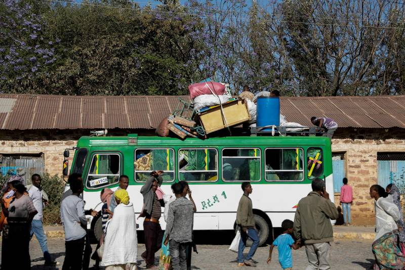 FILE PHOTO: A bus carrying displaced people arrives at the Tsehaye primary school, which was turned into a temporary shelter for people displaced by conflict, in the town of Shire, Tigray region, Ethiopia, March 14, 2021. REUTERS/Baz Ratner/File Photo