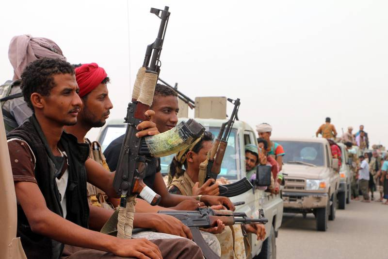 epa06805289 Yemeni forces backed by the Saudi-led coalition take position during an assault on the port city of Hodeidah, on the outskirts of Hodeidah, Yemen, 13 June 2018. According to reports, Yemeni government forces backed by the Saudi-led coalition launched a military offensive to regain control of the Red Sea port-city of Hodeidah acts as an entrance point for Houthi rebel supplies and humanitarian aid.  EPA/NAJEEB ALMAHBOOBI