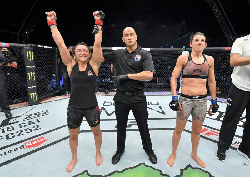 ABU DHABI, UNITED ARAB EMIRATES - JULY 26: Carla Esparza celebrates after her victory over Marina Rodriguez of Brazil in their strawweight fight during the UFC Fight Night event inside Flash Forum on UFC Fight Island on July 26, 2020 in Yas Island, Abu Dhabi, United Arab Emirates. (Photo by Jeff Bottari/Zuffa LLC via Getty Images)